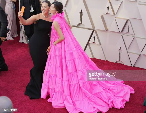 Ashley Graham and Gemma Chan attends the 91st Annual Academy Awards at Hollywood and Highland on February 24 2019 in Hollywood California