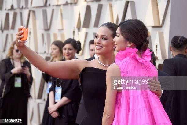 Ashley Graham and Gemma Chan pose for a selfie photo during the 91st Annual Academy Awards at Hollywood and Highland on February 24 2019 in Hollywood...