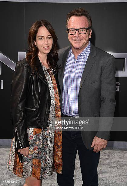 Ashley Groussman and actor Tom Arnold arrive at the premiere of Paramount Pictures' Terminator Genisys at the Dolby Theatre on June 28 2015 in...