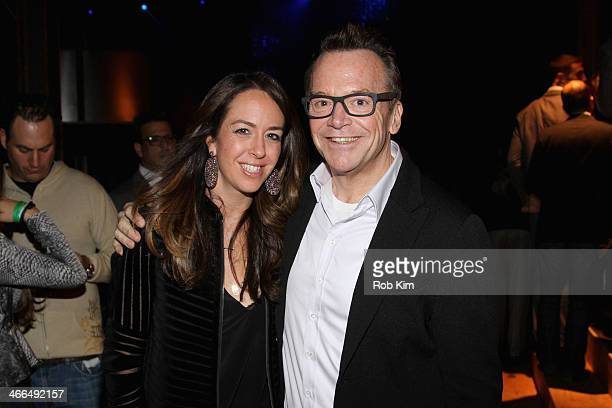 Ashley Groussman and actor Tom Arnold attend the DirecTV Super Saturday Night at Pier 40 on February 1 2014 in New York City
