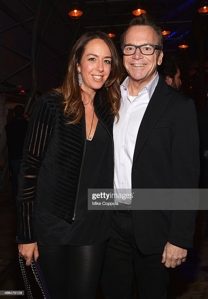 Ashley Groussman and Tom Arnold attend the DirecTV Super Saturday Night at Pier 40 on February 1, 2014 in New York City.