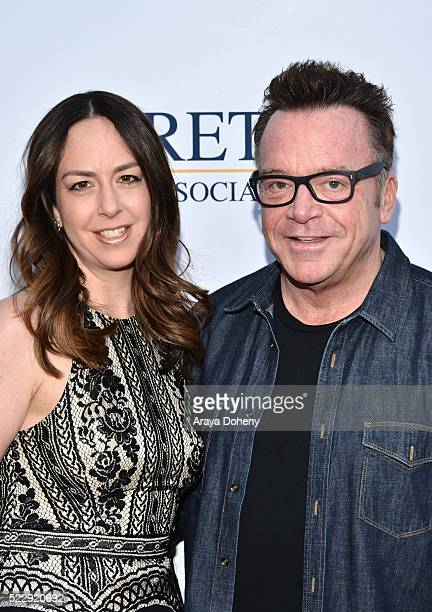 Ashley Groussman and Tom Arnold attend the Norma Jean Gala benefiting Hollygrove at Taglyan Complex on April 20 2016 in Los Angeles California