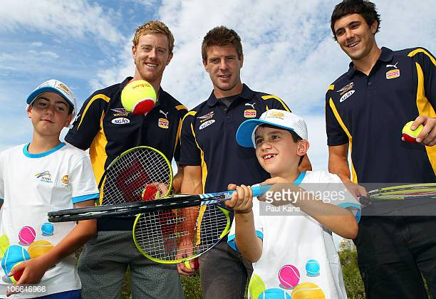 Ashley Hansen Beau Waters and Josh Kennedy of the West Coast Eagles pose with junior tennis players during the Australian Open trophy tour at King...
