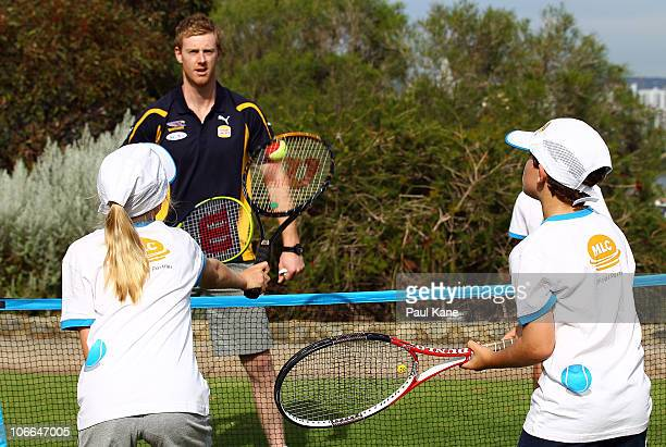 Ashley Hansen of the West Coast Eagles plays a game of modified tennis with junior tennis players during the Australian Open trophy tour at King Park...