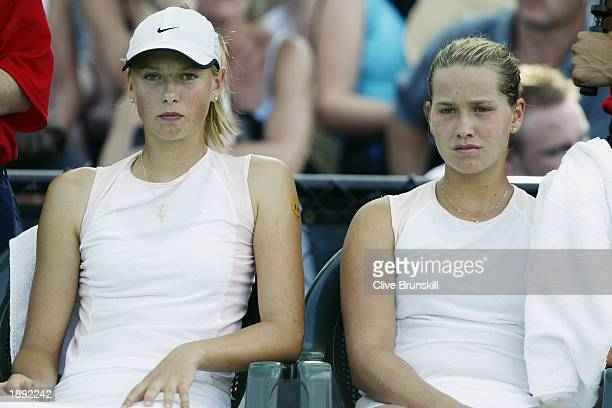 Ashley Harkleroad and Maria Sharapova watch during a break against Virginia Ruano Pascal and Paola Suarez during the Nasdaq100 Open March 22 2003 at...