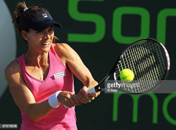 Ashley Harkleroad of the United States returns a shot to Alicia Monk of Australia during day one of the Sony Ericsson Open at Crandon Park Tennis...