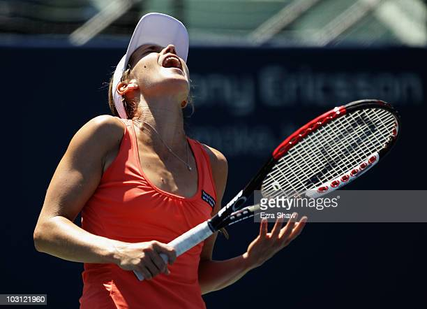Ashley Harkleroad of the USA reacts after missing a shot in her match against Marion Bartoli of France during Day 2 of the Bank of the West Classic...