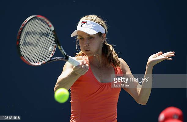 Ashley Harkleroad of the USA returns a shot to Marion Bartoli of France during Day 2 of the Bank of the West Classic at Stanford University on July...