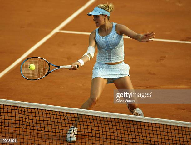 Ashley Harkleroad of the USA volleys a return in her third round match against Magui Serna of Spain during the fifth day of the French Open on May 30...