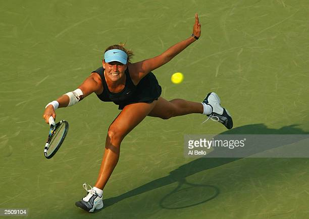 Ashley Harkleroad returns a shot to Vera Zvonareva during the US Open on August 27 2003 at the USTA National Tennis Center Flushing Meadows Corona...