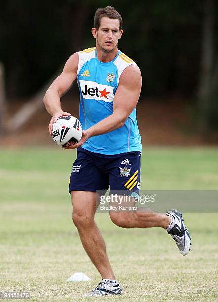 Ashley Harrison looks to pass during a Gold Coast Titans NRL training session at Robina on December 15 2009 at the Gold Coast Australia