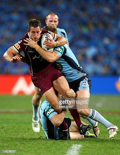 Ashley Harrison of the Maroons is tackled during game two of the ARL State of Origin series between the New South Wales Blues and the Queensland...