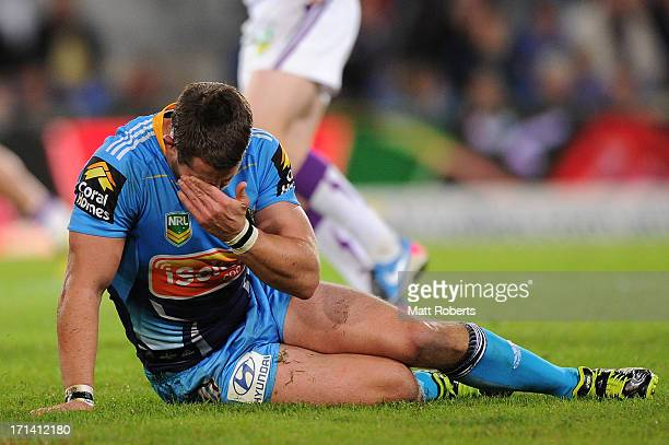Ashley Harrison of the Titans puts his hand to his face after making a tackle during the round 15 NRL match between the Gold Coast Titans and the...
