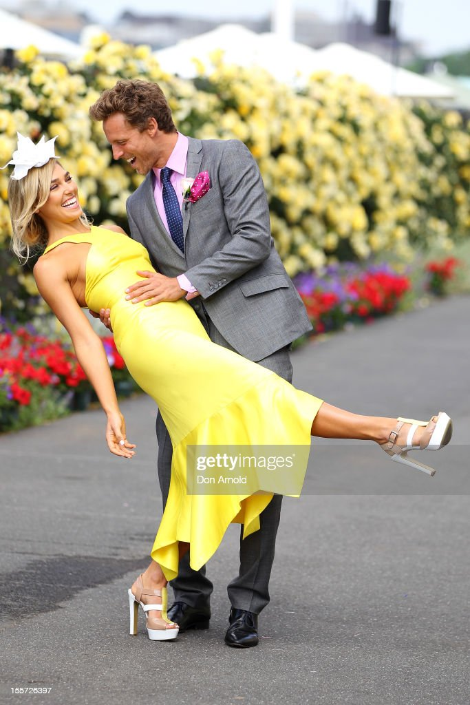 Ashley Hart and Buck Palmer pose for a photo in the birdcage on Crown Oaks Day at Flemington Racecourse on November 8, 2012 in Melbourne, Australia.