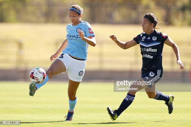Ashley Hatch of Melbourne City and Angela Beard of Melbourne Victory contest the ball during the round 11 WLeague match between the Melbourne Victory...