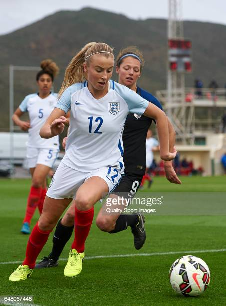 Ashley Hatch of USA competes for the ball with Leah Williamson of England during the international friendly match between USA Women U23 and England...