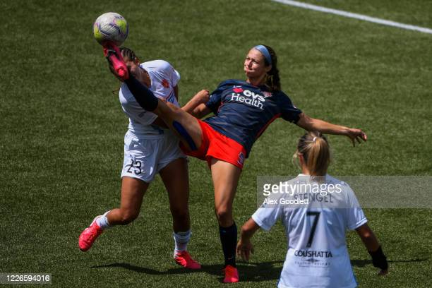 Ashley Hatch of Washington Spirit fights for the ball with Ally Prisock of the Houston Dash during day 7 of the NWSL Challenge Cup at Zions Bank...