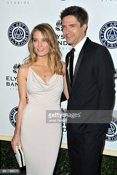 Ashley Hinshaw and Topher Grace arrive at The Art of Elysium presents Stevie Wonder's HEAVEN - Celebrating the 10th Anniversary at Red Studios on...