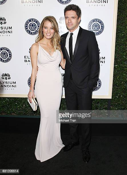 Ashley Hinshaw and Topher Grace arrive at The Art of Elysium celebrating the 10th Anniversary held at Red Studios on January 7, 2017 in Los Angeles,...