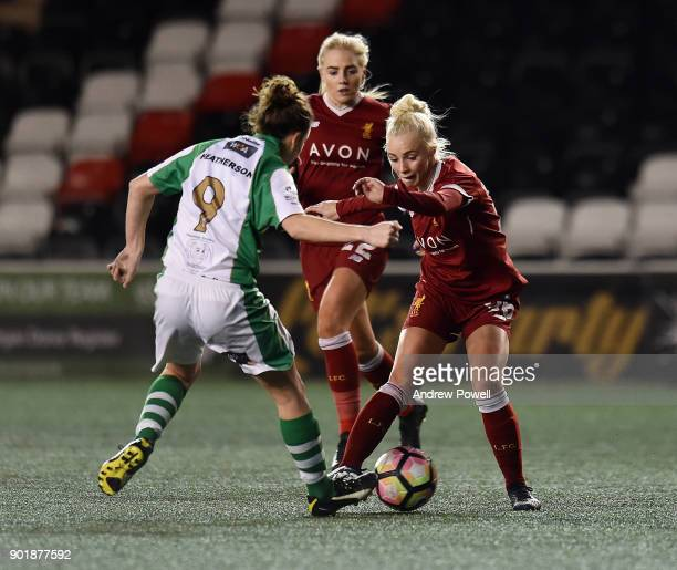 Ashley Hodson of Liverpool Ladies competes with AnnMarie Heatherson of Yeovil Town Ladiesbg during the FA Women's Super League match between...