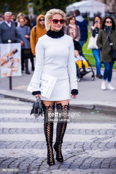 A guest is seen after the Chanel show during Paris Fashion Week Womenswear SS18 on October 3 2017 in Paris France