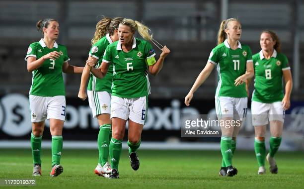 Ashley Hutton of Northern Ireland celebrates scoring her sides second goal in added time during the UEFA Womens Euro Qualifier match between Wales...