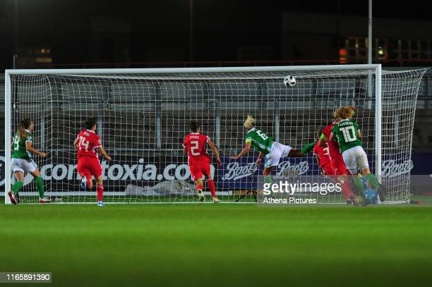 Ashley Hutton of Northern Ireland scores her side's equalising goal to make the score 22 during the UEFA Womens Euro Qualifier match between Wales...