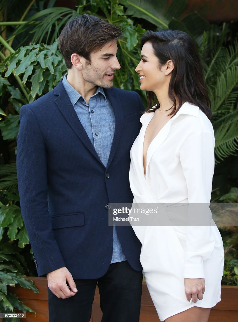 Ashley Iaconetti (R) and Jared Haibon arrive to the Los Angeles premiere of Universal Pictures and Amblin Entertainment's 'Jurassic World: Fallen Kingdom' held at Walt Disney Concert Hall on June 12, 2018 in Los Angeles, California.
