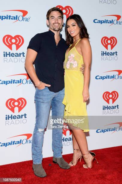 Ashley Iaconetti and Jared Haibon pose in the press room during the iHeartRadio Music Festival at TMobile Arena on September 21 2018 in Las Vegas...