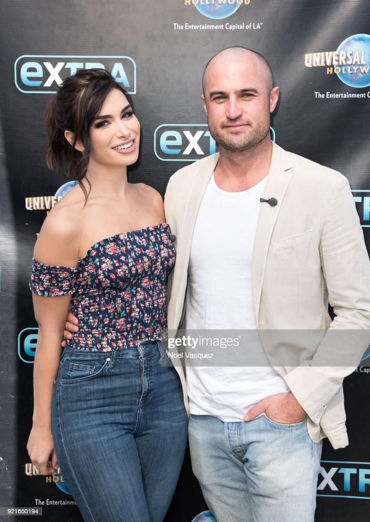 Ashley Iaconetti (L) and Jordan Mauger visit 'Extra' at Universal Studios Hollywood on February 20, 2018 in Universal City, California.