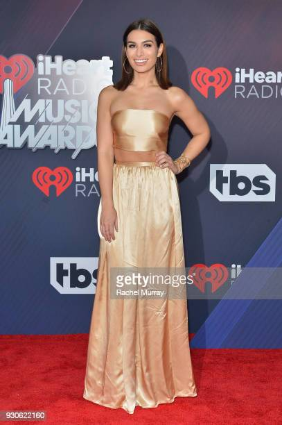 Ashley Iaconetti arrives at the 2018 iHeartRadio Music Awards which broadcasted live on TBS TNT and truTV at The Forum on March 11 2018 in Inglewood...