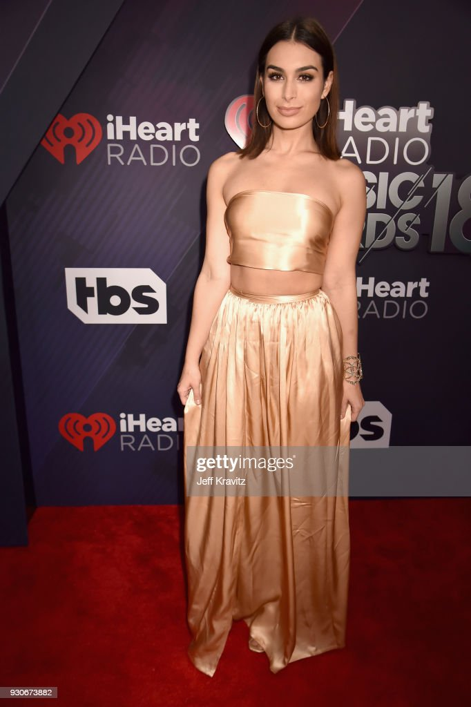 Ashley Iaconetti arrives at the 2018 iHeartRadio Music Awards which broadcasted live on TBS, TNT, and truTV at The Forum on March 11, 2018 in Inglewood, California.