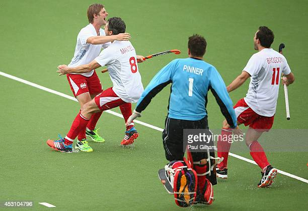 Ashley Jackson of England celebrates with Simon Mantell George Pinner and Alastair Brogdon after scoring the winning penalty during a penalty shoot...
