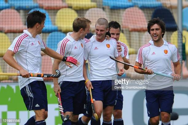 Ashley Jackson of England celebrates with team mates after scoring his team's third goal during the Men´s EuroHockey Championships 2011 Pool B match...