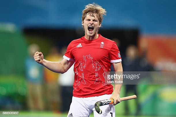 Ashley Jackson of Great Britain celebrates scoring a goal during the men's pool A match between Great Britain and Australia on Day 5 of the Rio 2016...