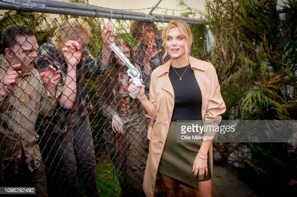 Ashley James interacts with The Walking Dead Zombie actors in character in an immersive display recreaing a scene from the Terminus story arc of...