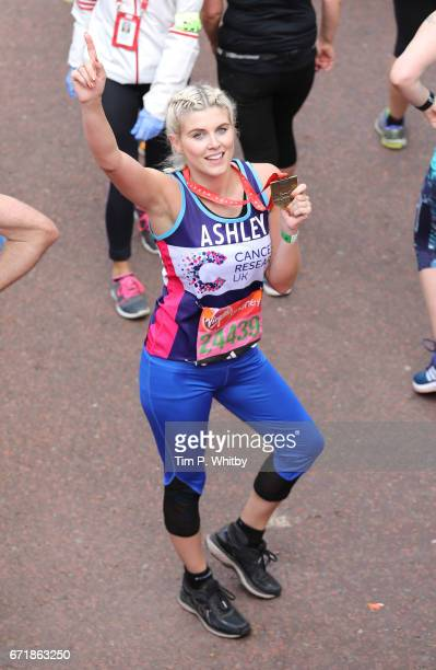 Ashley James poses for a photo after completing the Virgin London Marathon on April 23 2017 in London England
