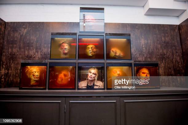 Ashley James seen inside an immersive display amongst The Walking Dead props from The Governor's office set from season 3 during The Walking Dead Art...