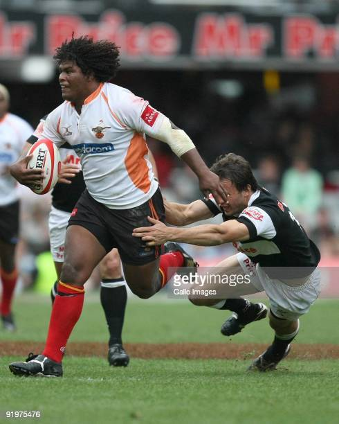 OCTOBER 17 Ashley Johnson of Cheetahs hands off Juan Hernandez of Sharks during the Absa Currie Cup semi final match between the Sharks and Cheetahs...