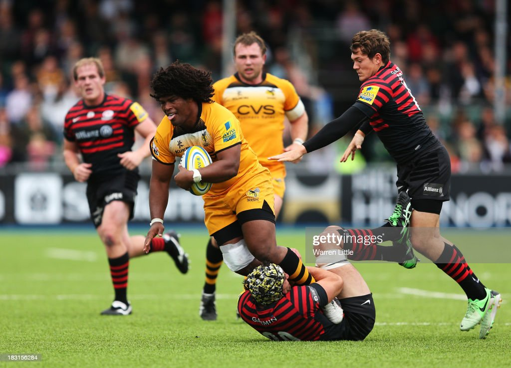 Ashley Johnson of London Wasps is tackled during the Aviva Premiership match between Saracens and London Wasps at Allianz Park on October 5, 2013 in Barnet, England.