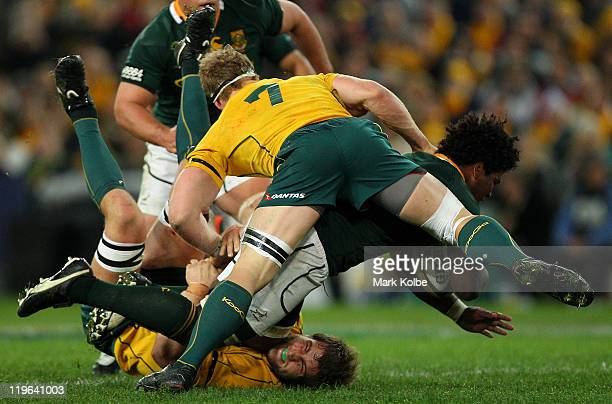 Ashley Johnson of the Springboks is tackled Ben McCalman of Wallabies during the TriNations match between the Australian Wallabies and the South...