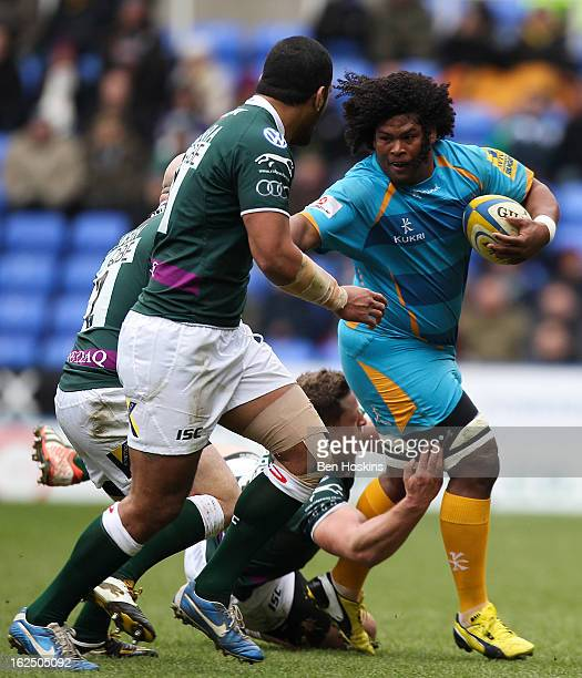 Ashley Johnson of Wasps hands off the tackle of Scott Lawson of London Irish during the Aviva Premiership match between London Irish and London Wasps...