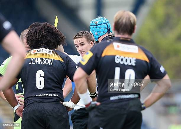 Ashley Johnson of Wasps is shown the yellow card by referee Luke Pearce during the Aviva Premiership match between Wasps and Northampton Saints at...