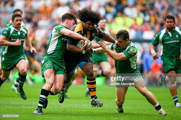 Ashley Johnson of Wasps is tackled by Alex Lewington and Johnny Williams of London Irish during the Aviva Premiership match between Wasps and London...