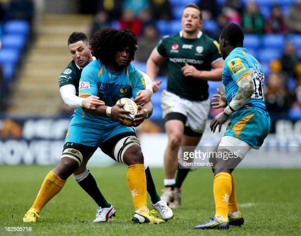 Ashley Johnson of Wasps is tackled by Ian Humphreys of London Irish during the Aviva Premiership match between London Irish and London Wasps at the...