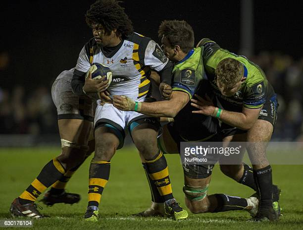 Ashley Johnson of Wasps tackled by Quinn Roux and Finlay Bealham of Connacht during the European Rugby Champions Cup Round 4 match between Connacht...