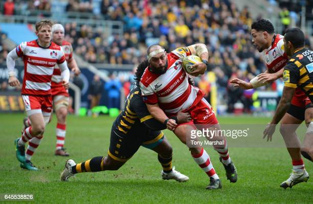 Ashley Johnson of Wasps tackles John Afoa of Gloucester Rugby during the Aviva Premiership match between Wasps and Gloucester Rugby at The Ricoh...