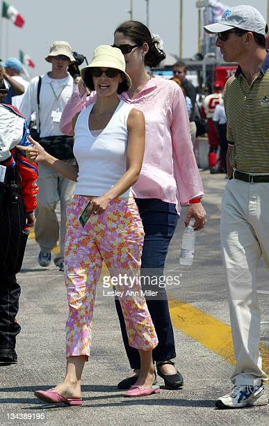 Ashley Judd shows some friends around the grid prior to the start of the race