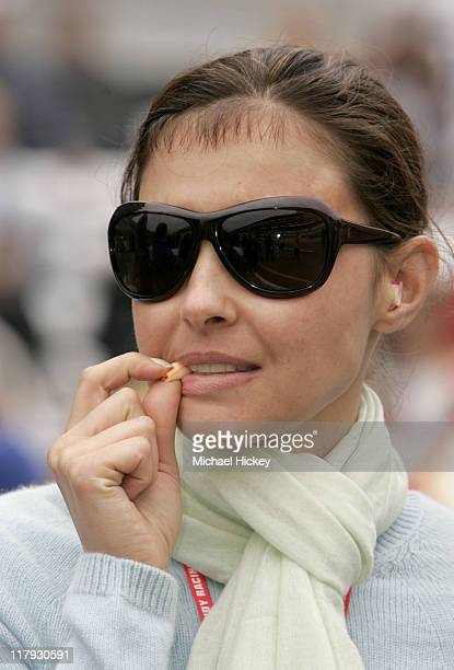 Ashley Judd wife of Dario Franchitti watches her husband during qualifying for the Indianapolis 500 at Indianapolis Motor Speedway May 15 2004