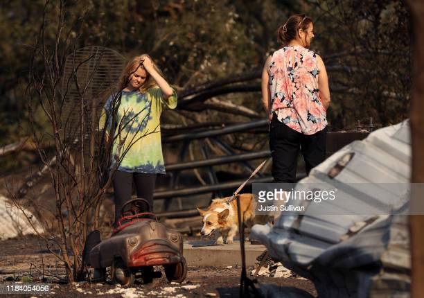 Ashley LaFranchi and Stephanie LaFranchi walk through a family home that was destroyed by the Kincade Fire on October 28 2019 in Calistoga California...